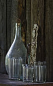 Still life - old bottle, glass, doorhandle — Foto de Stock