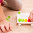 Smart little girl playing with mosaic in kids room — Stock Photo #22609793