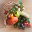 Stock Photo: Fresh vegetables in a wicker basket