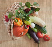 Vegetables in a wicker basket — Stock Photo