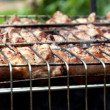 Grilling meat on a charcoal grill — Stock Photo