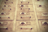 Old wooden office wall of files — Stock Photo