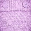 Background with Knitted lilac sweater with buttons — Stock Photo #23028512