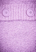 Background with Knitted lilac sweater with buttons — Stock Photo