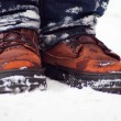 Winter men's boots in the snow — Stock Photo