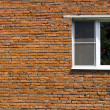 Window at the brick wall of the house — Stock Photo