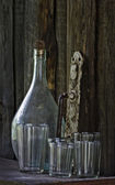 Still life - old bottle, glass, doorhandle — Stock Photo