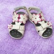 Children's summer sandals on lilac carpet — Stock Photo #24340921