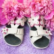 Children's sandals on lilac carpet — Stock Photo