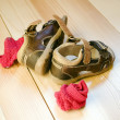 Stock Photo: Children's sandals on wooden floor