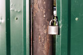 Locked iron door — Stock Photo