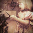 Little girl with Christmas tree — Stock Photo #28201875
