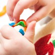 Child moulds from plasticine, hands with plasticine — Stock Photo #30146821