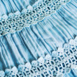 Photo of a blue skirt with the assembly and lace — Stock Photo #31480893