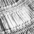 Black-and-white fabric with the assembly and lace — Stock Photo