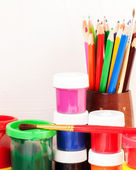 Paints, brushes and colored pencils — Stock Photo