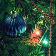 Beautiful christmas decorations on xmas tree — Stock Photo #34239921