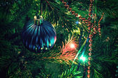 Beautiful christmas decorations on xmas tree — Stock Photo