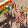 Empty chain swings on summer kids playground — Stockfoto