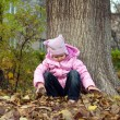 Stock Photo: Little girl Playing in Autumn Park Leaves