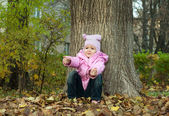 Little girl Playing in Autumn Park Leaves — Stock Photo