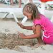 Stock Photo: Baby girl on the beach. vacation on beach