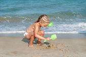 Baby girl on the beach. vacation on beach — Stock Photo