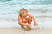 Baby girl on the beach. vacation on beach — Stock Photo