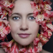 Portrait of a beautiful woman in flowers — Stock Photo