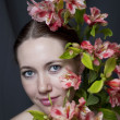 Portrait  young woman with flowers — Stock Photo
