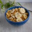 Corn flakes in a blue plate — Stock Photo