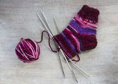 Knit a sock on the needles — Stock Photo