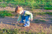 Child in the jeans coverall on the outing — Stok fotoğraf