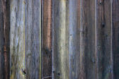 Background - old dark vertical wood board — Stock Photo
