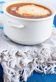 Vegetable soup with sour cream and tea towel on the blue — Stock Photo