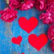 Stock Photo: Hearts and many red rose on blue wood board