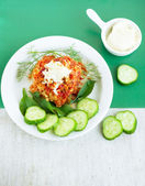Meatball with sour cream and cucumber — Stock Photo