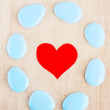 Heart in the frame of blue pebble — Stock Photo