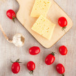 Cheese, tomato, garlic, top view — Stock Photo #27148037