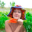 Stock Photo: Dreamy womwith bunch of carrots