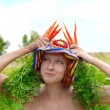 Stock Photo: Eccentric woman with fresh carrot