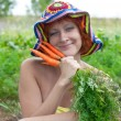 Stock Photo: Red-haired womwith bunch of carrots
