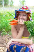 Happy woman with bunch of carrots — Stock Photo