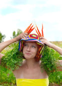 Eccentric woman with fresh carrot — Stock Photo