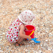 Little girl play on the sea coast — Stock Photo #27665549