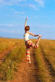 Beautiful slender woman employ gymnastics barefoot — Stock Photo