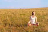Beautiful woman meditate outdoors — Stock Photo