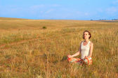 Slender woman meditate outdoors — Stock Photo