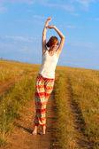 Beautiful happy woman dance barefoot — Stock Photo