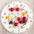 Refined round plate with plums — Stock Photo